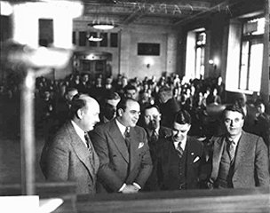 0703386cd9f Al Capone (hands folded) in court with his attorneys